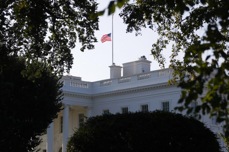 The American flag flies at half-staff above the White House in honor of Sen. John McCain, R-Ariz., Sunday, Aug. 26, 2018, in Washington. McCain, 81, died Saturday at his ranch in Arizona after a yearlong battle with brain cancer.