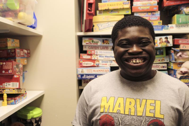Jaqavius Gordon flashed a smile as he worked on picking a game to play with his speech therpaist at the Navicent Autism Center in Macon, GA.