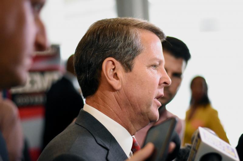 Republican gubernatorial nominee Brian Kemp speaks to reporters at his Atlanta campaign headquarters.