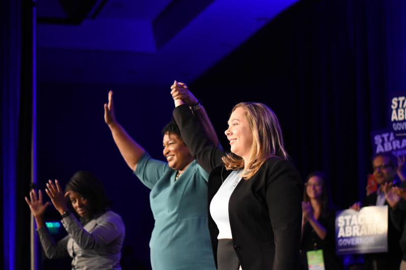 The Democratic Party of Georgia's nominee for governor Stacey Abrams (left) and lieutenant governor nominee Sarah Riggs Amico take the stage in Atlanta at the party's state convention Saturday, Aug. 25.
