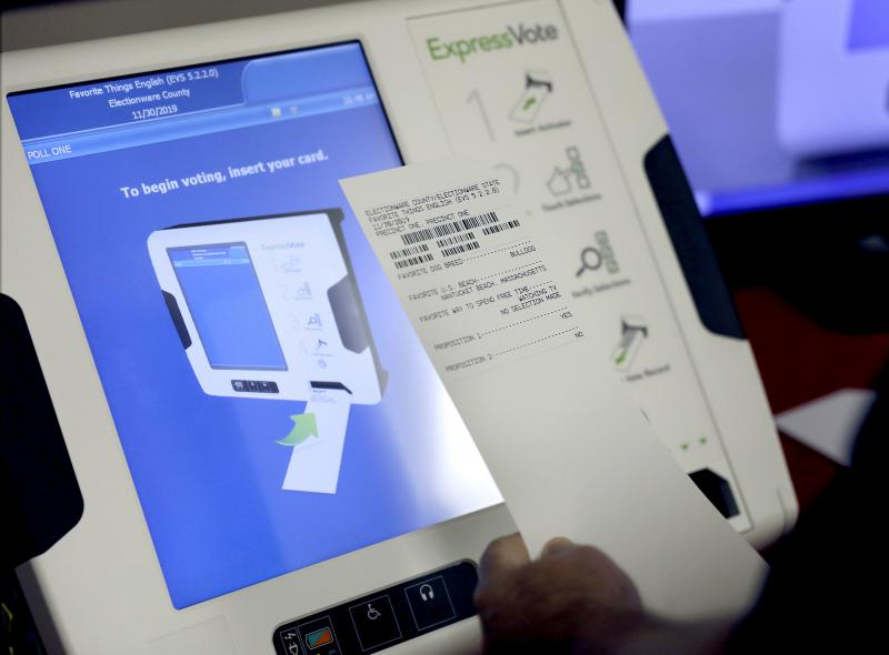 A new voting machine which prints a paper record sits on display at a polling site in Conyers, Ga.