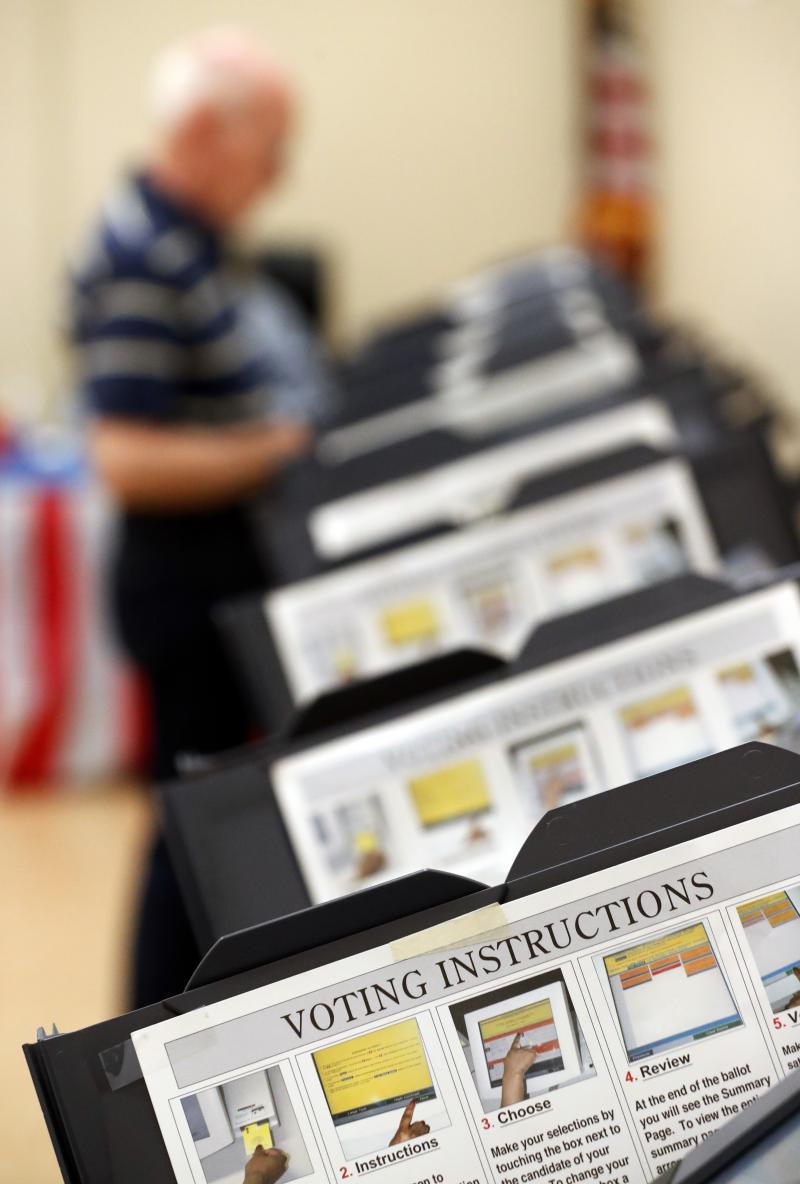 Voter casting his ballot in Sandy Springs, Ga.