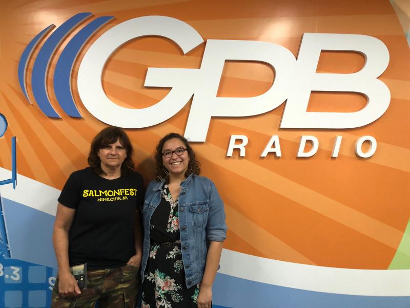 Amy Ray, left, standing with producer Elena Rivera, right.