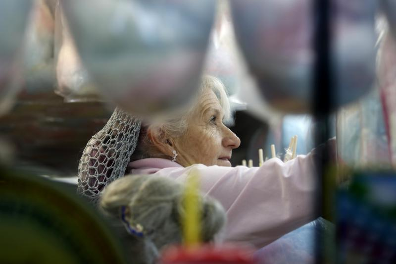 Karen Koesler, 63, an employee at Perfection Confections from Streator, Illinois, works at the Georgia National Fair on Friday, October 5, 2018, in Perry, Georgia. The Georgia National Fair is open Oct. 4 through 18, 2018.