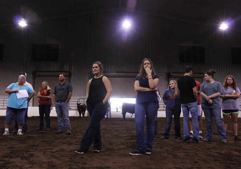 Family and friends of show cow contestants wait to hear the results of the Heifer Show Cow competition at the Georgia National Fair in Perry, Georgia, on Saturday, Oct. 6, 2018.