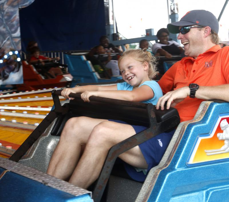 Stuart Walker and his daughter, Dorothy Walker, age seven, ride together at the Georgia National Fair in Perry, Georgia, on Saturday, Oct. 6, 2018. Walker is from Macon, Georgia, and works as an attorney.