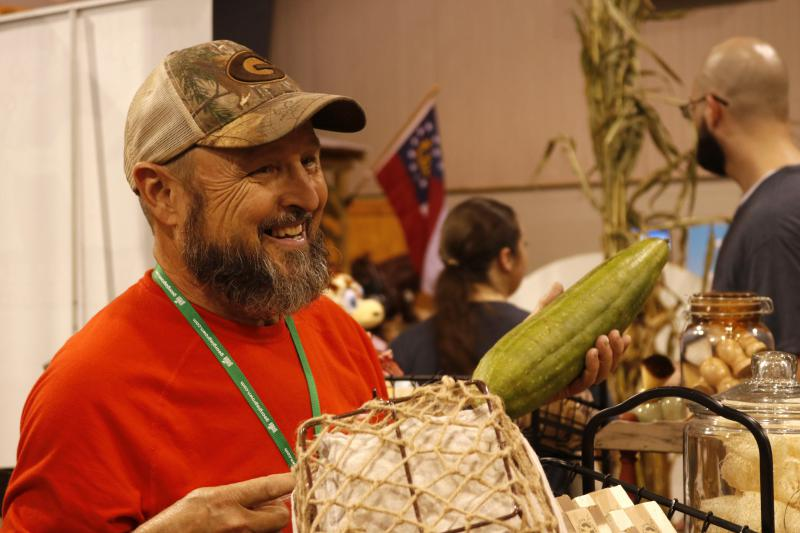 Alan Carr Jr., 63, talks to a customer at his booth as part of the Georgia Grown showcase at the Georgia National Fair in Perry on Saturday. Carr owns Bone Creek Farms, which sells goat milk, soap and other body products.