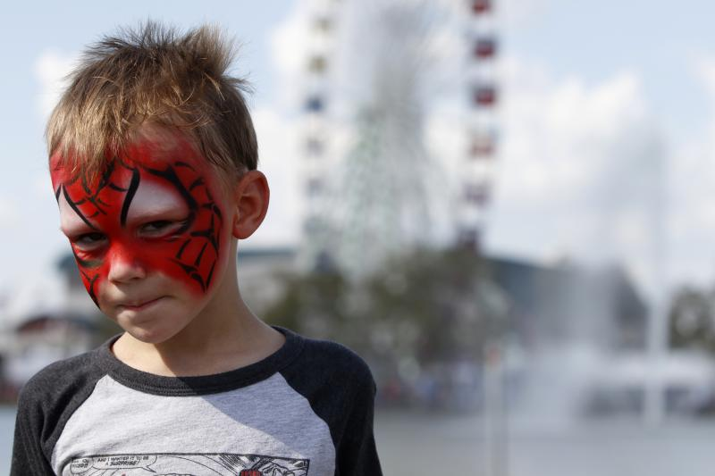 Connor Marino, 4, of Tifton, poses to show off his Spider-Man face paint on Saturday at the Georgia National Fair in Perry. Marino was also wearing a Spider-Man shirt and had a Spider-Man blow-up toy.