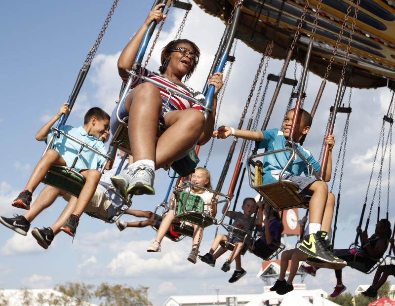 Krystal Sharpe screams on a ride with her 6-year old son Khalil Sharpe at the Georgia State Fair on Saturday. The Sharpes of Atlanta came down for the weekend to enjoy the fair and give Khalil a chance to record videos for his YouTube channel.