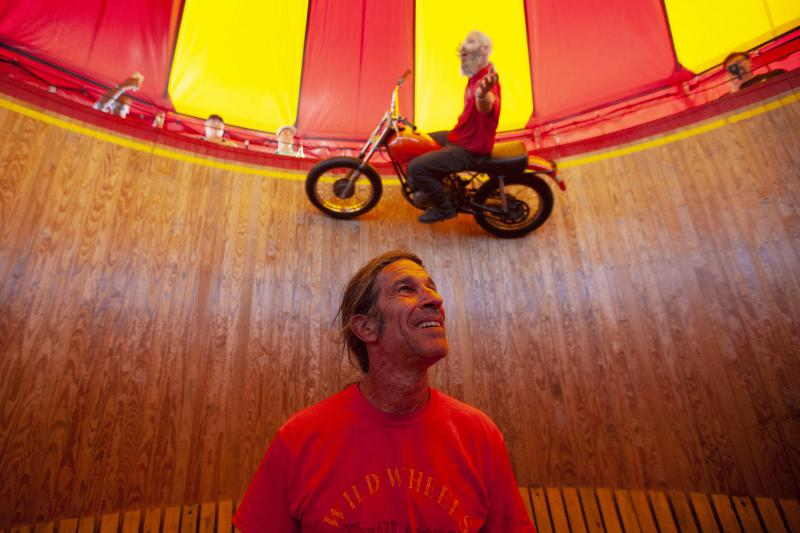 Dallas Dan, 58, watches Lee Donham, 38, perform tricks for the attendants of the Georgia State Fair on Saturday. Wild Wheel's Wall of Death is one of the last of its kind still touring with fairs.