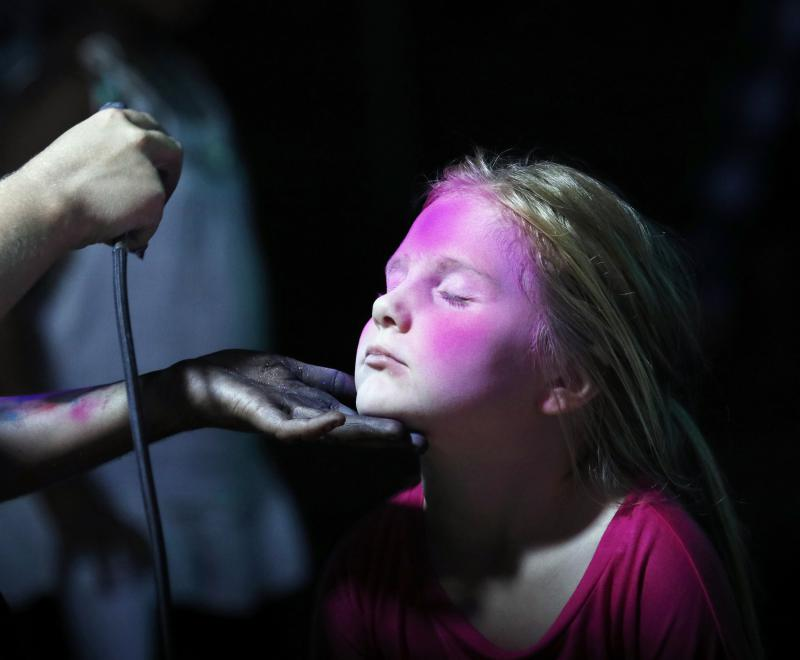 Dakota Miller, 8, gets her face painted on Saturday night at the Georgia National Fair.