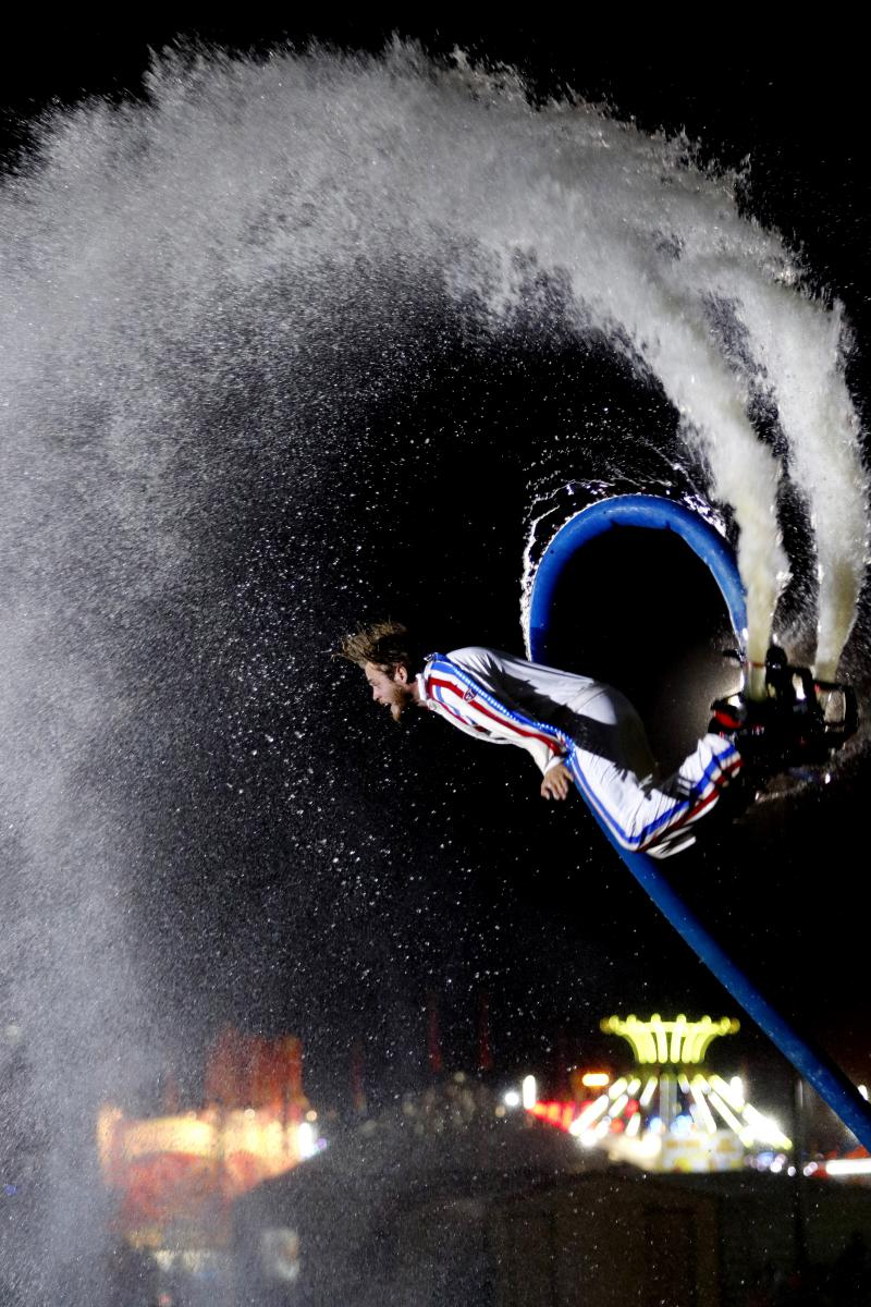 Sam Coenen of the Nerveless Nocks performs on a flyboard at the Georgia National Fair on Saturday. The Nocks are a group of stunt artists that perform in front of a variety of audiences around the world at fairs, theaters, theme parks and circuses.