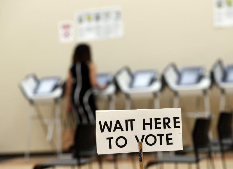 Voter casts ballot in Sandy Springs, Ga.