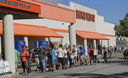 People line up outside a Home Depot for a new supply of generators and plywood in advance of Hurricane Florence in Wilmington, N.C., on Sept. 12, 2018.