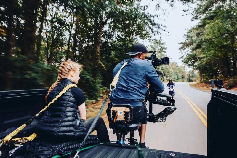 Taraja Ramsess operating a camera on a set.
