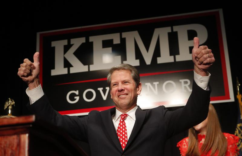 Georgia Republican gubernatorial candidate Brian Kemp gives a thumbs-up to supporters, Wednesday, Nov. 7, 2018, in Athens, Ga.