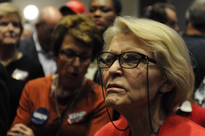 Republican State Rep. Susan Holmes waits as results come in during Brian Kemp's election night party.
