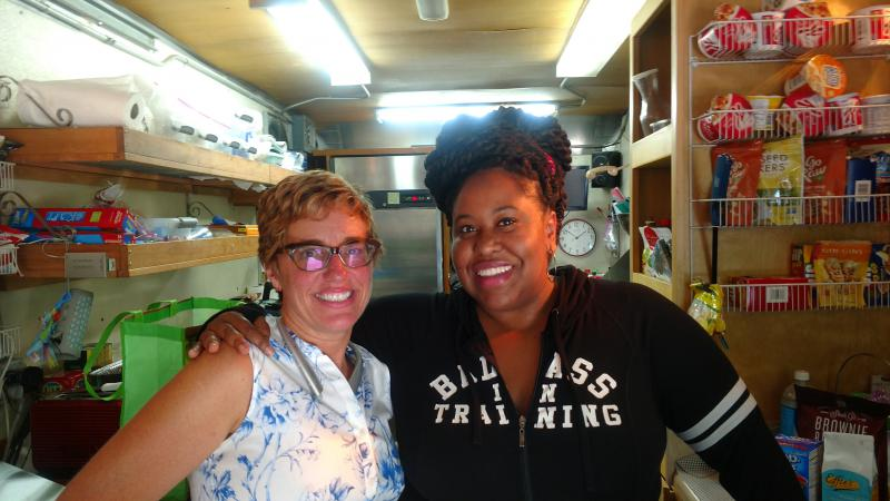 Stepanie Morales and Kalena Boller on Stephanie's food truck during a TV production in Stone Mounrtain.