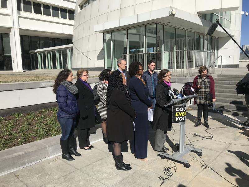 Lauren Groh-Wargo announces the lawsuit Fair Fight Action and Care In Action are bringing against the state.