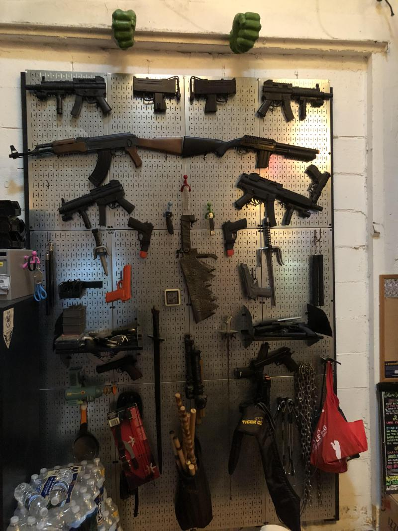 In Elizabeth's stunt studio in Atlanta, there is an armory on one of the walls with a wide variety of fake weapons.