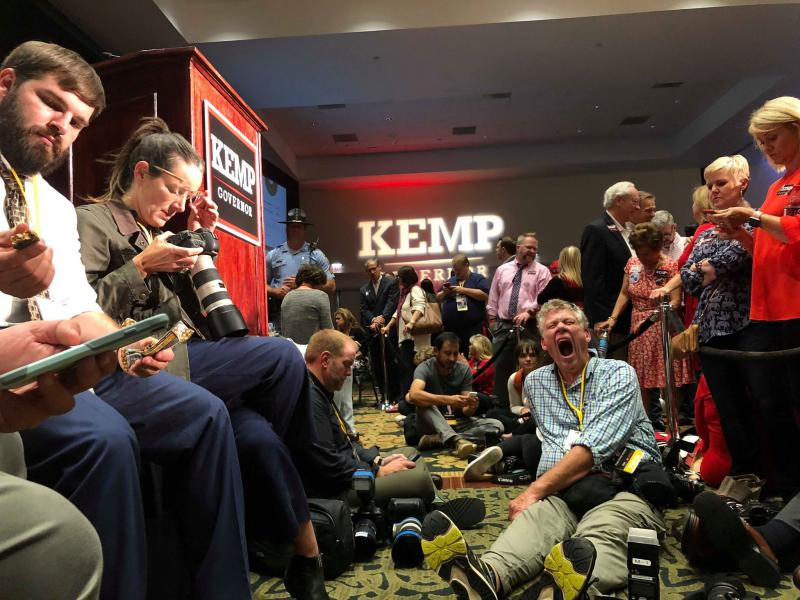 Journalists wait after 2 a.m. to hear Brian Kemp speak to supporters.