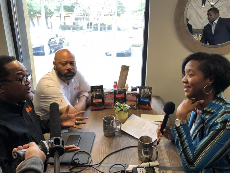 Deron Moreman and Ricardo Richardson speak with GPB's Leah Fleming at Rosie's Coffee Cafe in Atlanta
