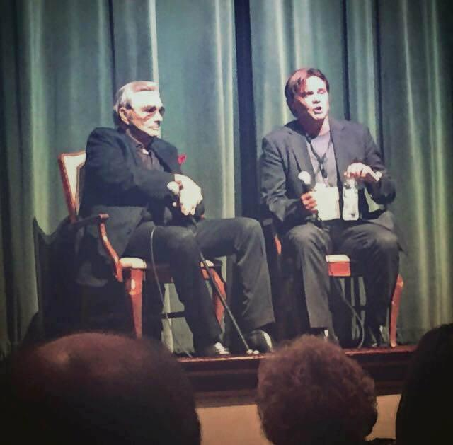 Terrell Sandefur (r) during a Macon Film Festival panel with actor Burt Reynolds in 2015.