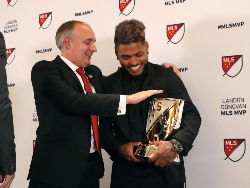 Josef Martinez laughs with Atlanta United President Darren Eales after receivng the MVP trophy.