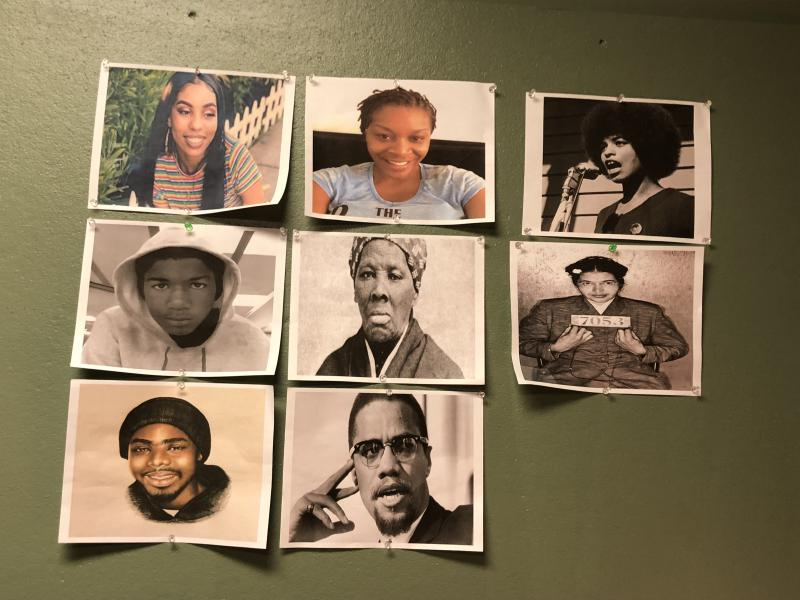 Nafessa Williams' dressing room wall. Pictured are activists and shooting victims who inspire her (l to r): Nia Wilson, Sandra Bland,  Angela Davis, Trayvon Martin, Harriet Tubman, Rosa Parks, Oscar Grant, and Malcolm X.