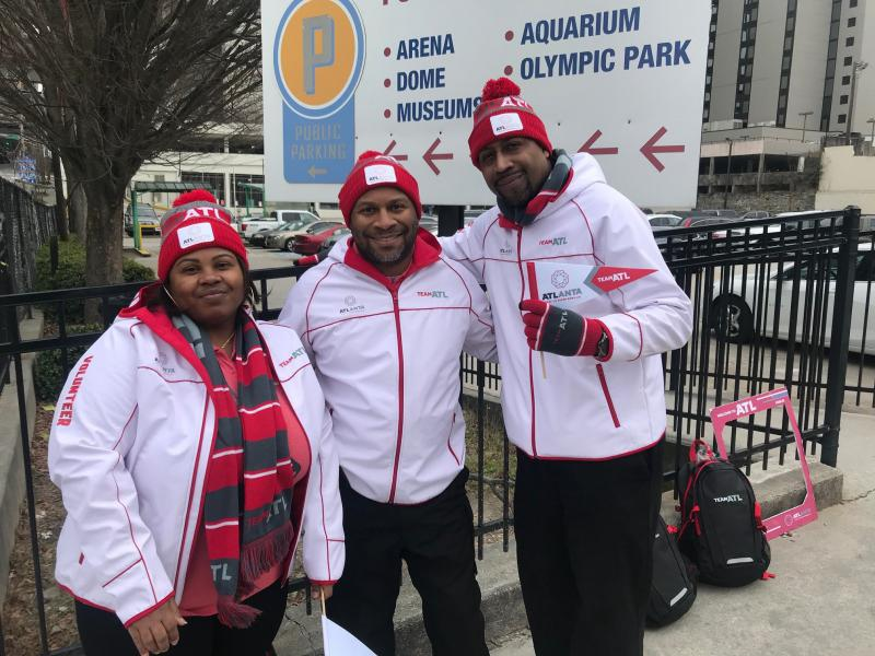 Ashley Washington, Anthony Laidler and Roy Holliman are three of the 10,000 volunteers helping visitors navigate the Super Bowl.