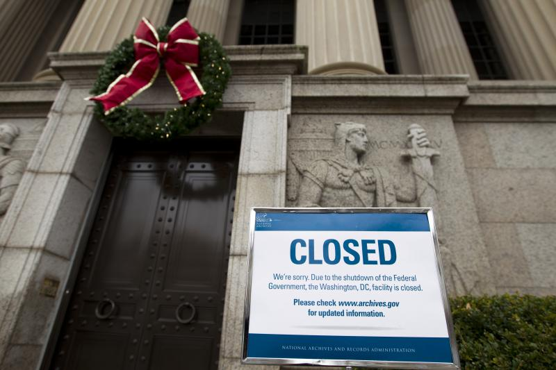 A closed sign is displayed at The National Archives entrance in Washington as a partial government shutdown stretches into its third week.