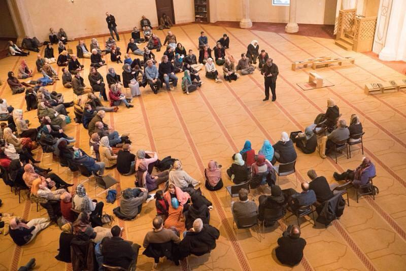 """People gathered at Al-Farooq Masjid for a """"Vist a Mosque"""" event hosted by the Islamic Speakers Bureau of Atlanta."""