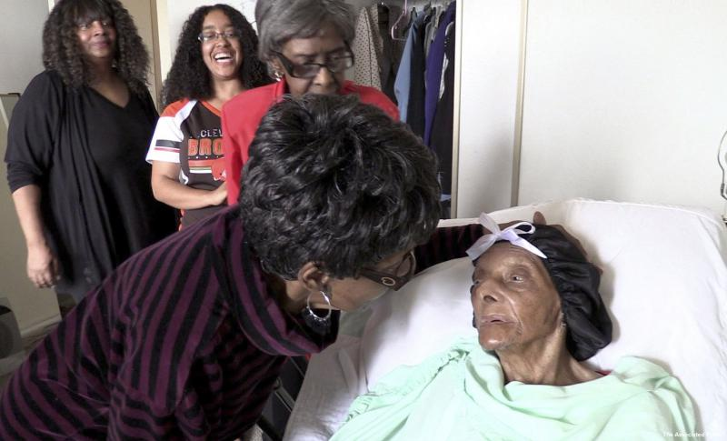 Lessie Brown, right, is visited by her daughters, Verline Wilson, foreground, and Vivian Hatcher, third from left, and other family and friends at her home Sept. 22, 2018 in Cleveland Heights, Ohio.