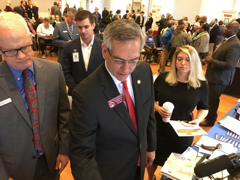Incoming secretary of state Brad Raffensperger demos a voting machine from Hart InterCivic in downtown Atlanta Thursday January 3, 2019.