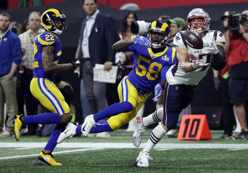 New England Patriots' Rob Gronkowski (87) catches a pass in front of Los Angeles Rams' Marcus Peters (22) and Cory Littleton (58) during the second half of the NFL Super Bowl 53 football game Sunday, Feb. 3, 2019, in Atlanta.