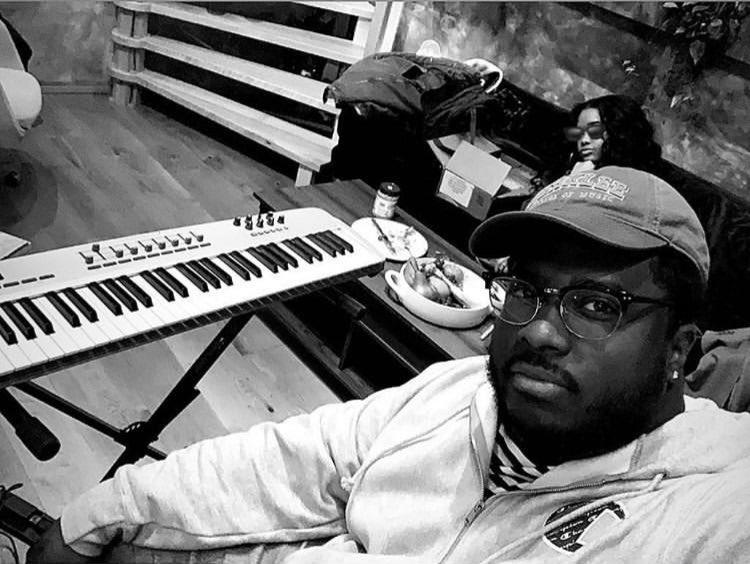 David Harris in studio with musician, H.E.R.
