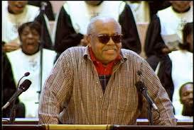 Alley Pat speaking at Civil Rights leader, Hosea Williams' funeral in 2000.