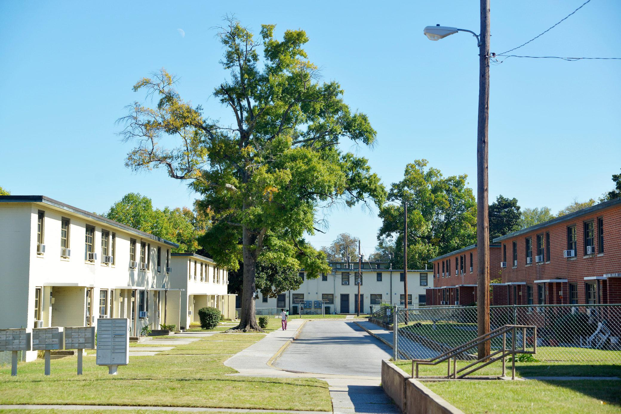 How far can you get from public housing with help for Home builders in macon ga