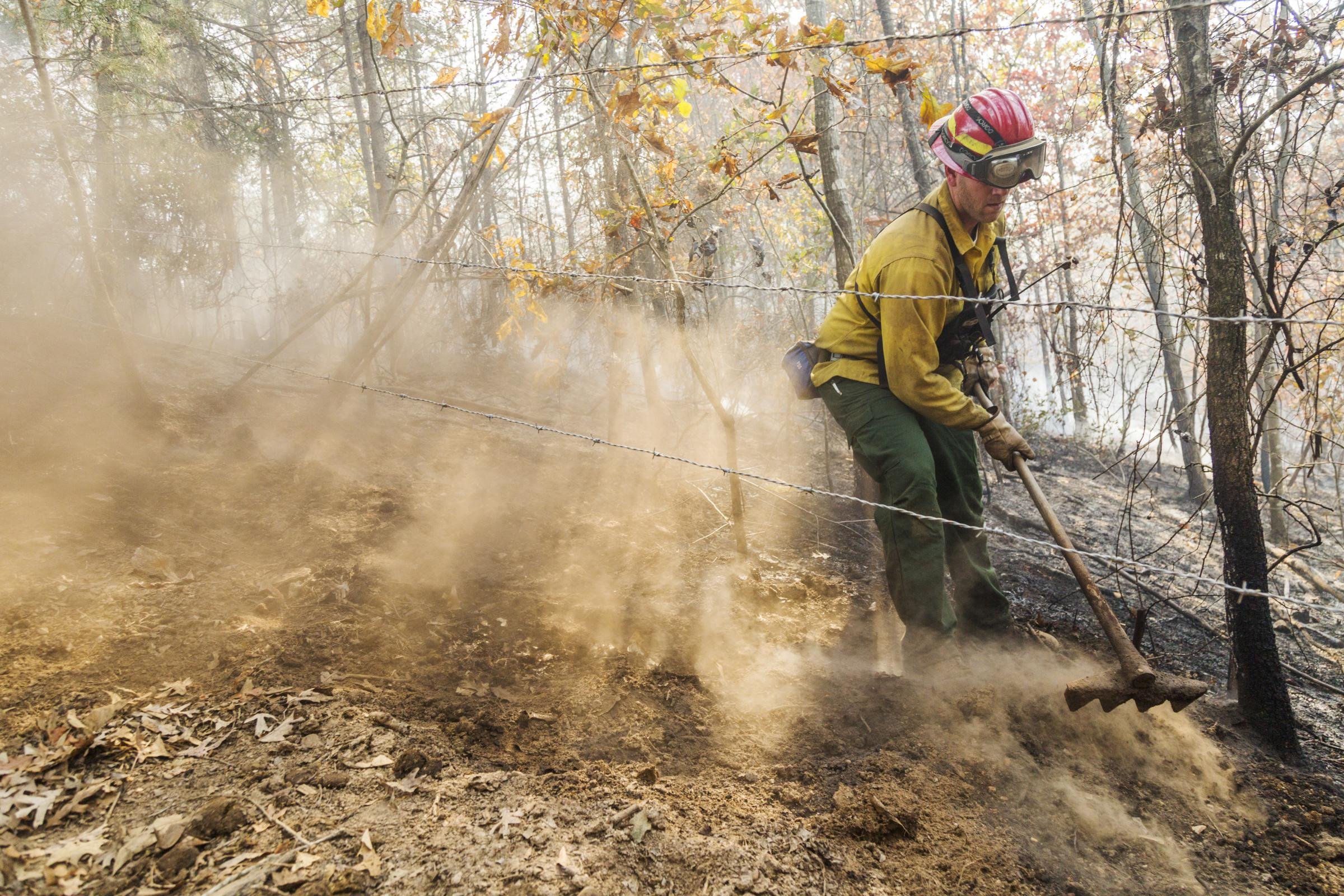 Georgia Forestry Commission Ranger Eric Evans Uses A Fire Rake To Get Flammable Material Both Above And Below Ground Out Of The Way Of A Fire In Gordon