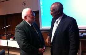 Fred Poston (left) talks with MSU Trustee Joel Ferguson after being appointed Dean of the MSU College of Agriculture and Natural Resources. He leaves the vice presidency for Finance and Operations.