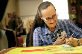 Peckham Inc. client Karen Kinsey works on her contribution to the Art@work project.