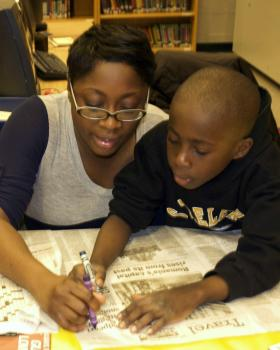 Parents and children work together for literacy fun.