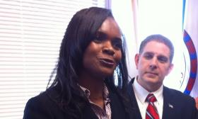 Lansing Mayor Virg Bernero looks on as City Attorney Designate Janene McIntyre speaks with reporters at City Hall.