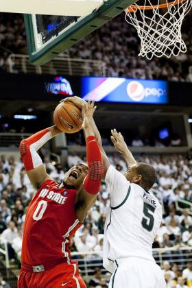 Coach Izzo is helping junior forward Adreian Payne look into his NBA draft prospects.