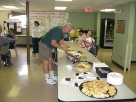 In addition to regular social happenings like this open house luncheon (pictured), the club provides members with outings to other local events, like baseball games.
