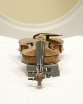 The Stradivarius Violin sits on the CT bed, waiting for scan.
