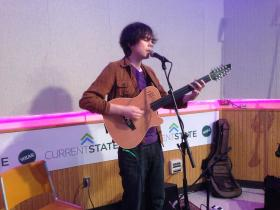 Musician Elden Kelly of Richmond, Vermont plays his guitar and sings live in the Current State studio at WKAR.