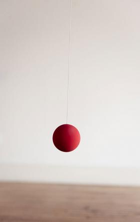 The Lisa Walcott piece 'Vice Versa' is a series of red balls suspended on elastics that continually bounce.