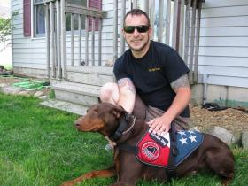 Eric Calley served in the U.S. Marine Corps in Iraq.  He's the co-founder of the veterans' advocacy group, The Fight Continues.  He's pictured with his service dog, Liberty.