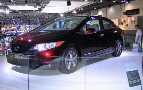 The hydrogen-powered Honda FCX Clarity boasts zero emissions but is not yet available for purchase - only for leasing in areas with publicly available refueling stations.